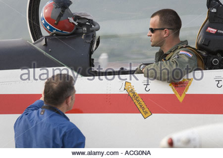 Croatian Air Force Pilatus PC-9 trainer aircraft, pilot and mechanic talking - Stock Image