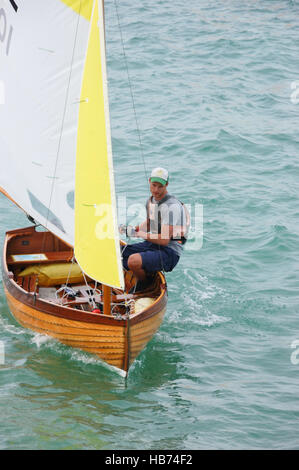 Young man in a Sea View One-Design (SVOD) Dinghy class boat on The Solent at Seaview on the Isle of Wight - Stock Image