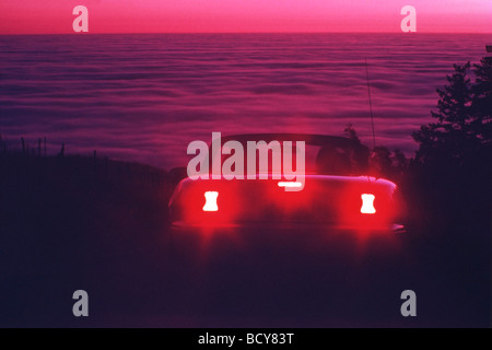 rear view of convertible at sunset - Stock Image