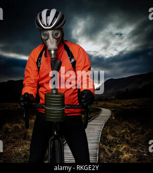 A cyclist in a polluted world - Stock Image