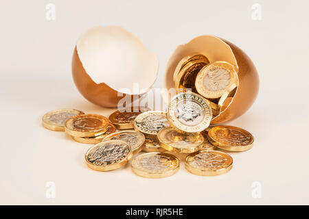 Golden Nest Egg with Shinny Pound Coins - Stock Image