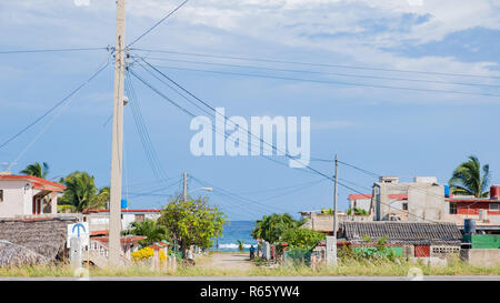Small town along the north coast of Cuba with the Atlantic in the background. - Stock Image