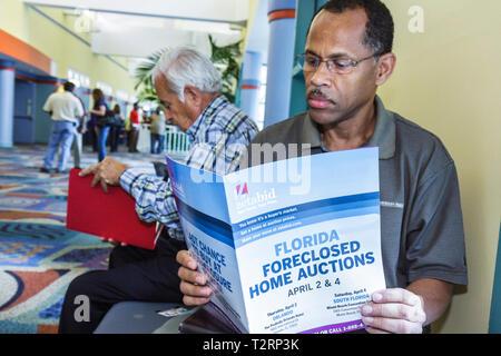 Miami Beach Miami Florida Beach Convention Center centre Foreclosed Home Auction foreclosure real estate crisis economy economic - Stock Image