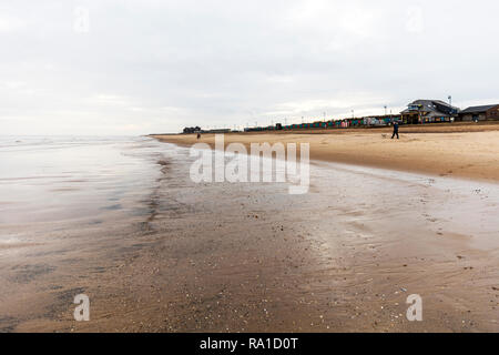Mablethorpe, Lincolnshire, UK. 30th December 2018. Overcast skies on the East Coast of the UK at Mablethorpe beach 30/12/2018 cloudy sky with the sun trying to burn through Credit: Tommy  (Louth)/Alamy Live News - Stock Image