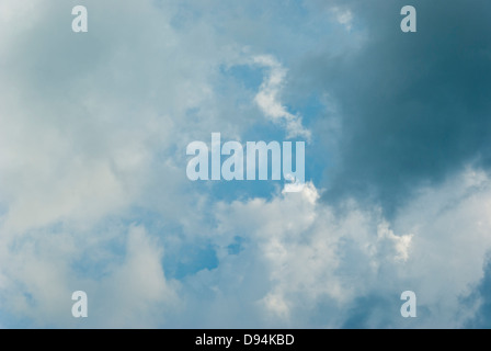 Ragged cumulus clouds on a showery day. - Stock Image