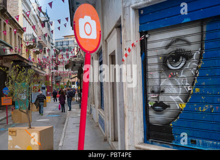 Colourful bunting, street art and signs mark the busy shopping area of Monastiraki with its flea markets and great deals, Athens, Greece, Europe. - Stock Image