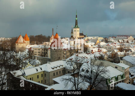 Winter in Tallinn old town with St Olaf's church in the distance. - Stock Image