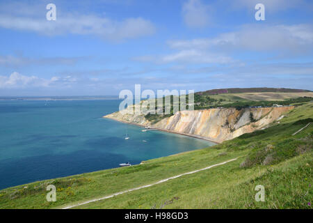 Alum Bay with it's multi-coloured sand cliffs seen from the Needles Headland. - Stock Image