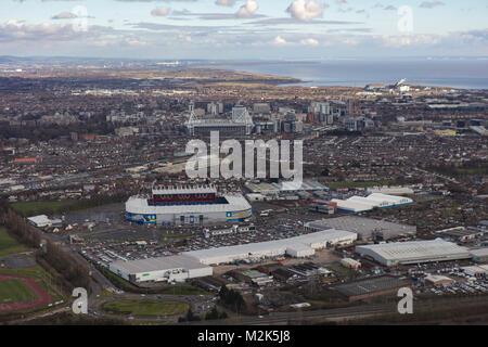 An aerial view of the skyline of the Welsh Capital Cardiff with the Bristol Channel visible beyond - Stock Image