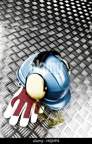 hard-hat, ear-mufs and industrial saFETY CLOTHING - Stock Image