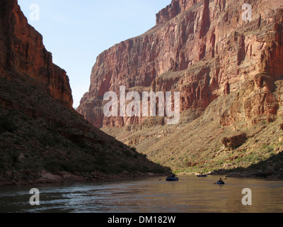A group of boats work down the Colorado River through the Grand Canyon - Stock Image
