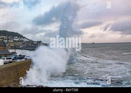 Huge Wave from storm Diana crashing over the harbour wall at Mousehole - Stock Image