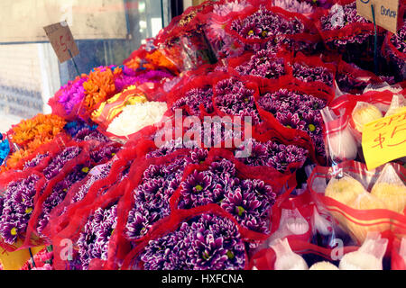 Bright flower bouquets for sale at a deli. - Stock Image