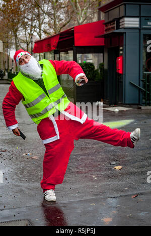 Paris, France. 1st December, 2018. Yellow Vest protester with Santa Claus costume during the Yellow Vests protest against Macron politic. Credit: Guillaume Louyot/Alamy Live News - Stock Image