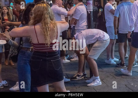 11th June 2018 Approximately fifty police officers deployed in Brentwood Essex  following England losing against Croatia.  Fans tears turned to disorder and Essex police had to clear fans down the entire length of the High Street.  One small group of fans challenged the police and arrests were made. Credit Ian Davidson/Alamy Live News - Stock Image