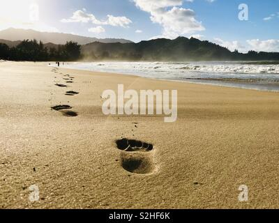 Footprints on the beach. Hanalei Bay, Kauai USA. - Stock Image