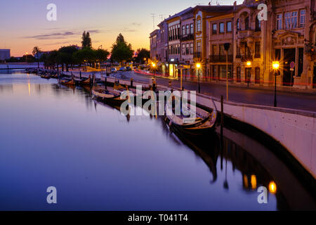 Canal in Aveiro with tourist boats parked for night  during blue hour. Long exposure. In Aveiro Portugal, June 23, 2017 - Stock Image