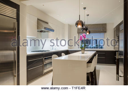 Modern kitchen with pendant lights - Stock Image