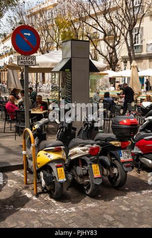 Spain, Cadiz, Plaza del Mentidero, motorcycle parking area - Stock Image