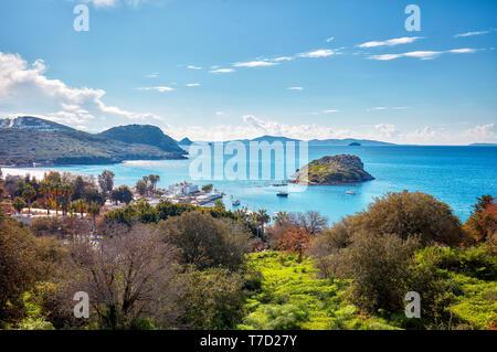 Beautiful landscape view of touristic Gumusluk bay and rabbit island in Bodrum, Mugla, Turkey - Stock Image