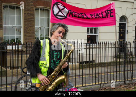Bethnal Green,London, UK. 30th March 2019. Extinction Rebellion environmental protest and road blockade of junction of Cambridge Heath Road and Roman Road in Bethnal Green. Organised by Extinction Rebellion Tower Hamlets. Credit: Stephen Bell/Alamy Live News. - Stock Image