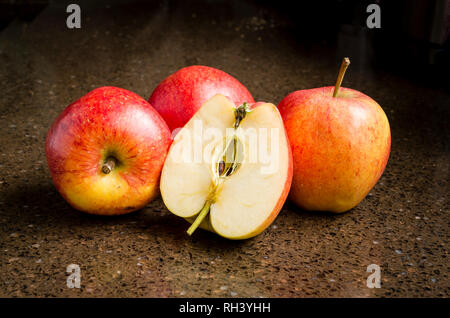 Best of British Daliclass eating apples ready for consumption in the winter in UK showing clean flesh when halved - Stock Image