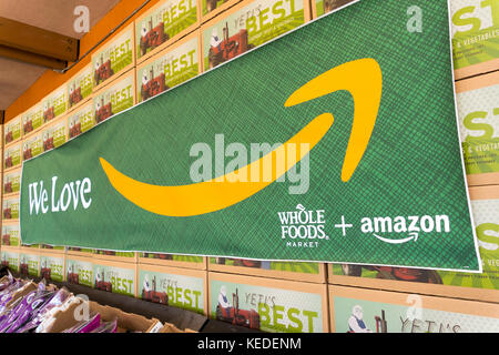 Amazon and Whole Foods sign on Cupertino Whole Foods Market Store - Stock Image