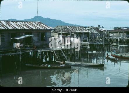 Muslim fishing village with houses on stilts, near Kota Kinabalu; Sabah, North Borneo, Malaysia. - Stock Image