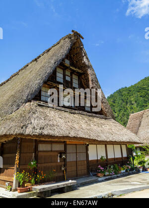 Pretty wooden houses are the reason for the UNESCO World Heritage Site at Shirakawa-go, Japan. Traditional style - Stock Image