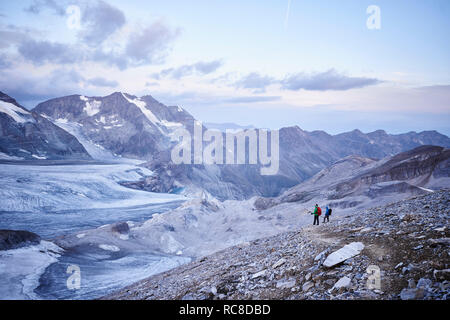 Hiker friends looking at glacier, Mont Cervin, Matterhorn, Valais, Switzerland - Stock Image