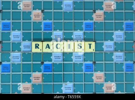 Racist written in Scrabble tiles - Stock Image