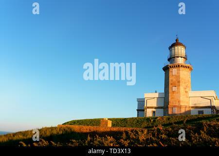 Matxitxako lighthouse in Bermeo with blue sky - Stock Image