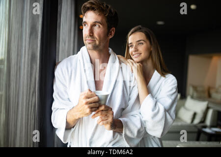 Happy married couple relaxing at modern wellness spa resort - Stock Image