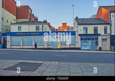 Closed and boarded up public house in the centre of Norwich - Stock Image