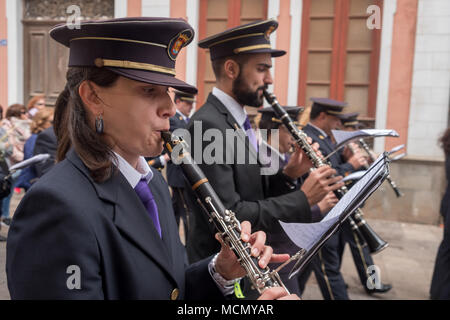 Tenerife, Canary Islands, a marching brass band of men and women plays during the Palm Sunday Holy Week procession through the streets of La Laguna. - Stock Image