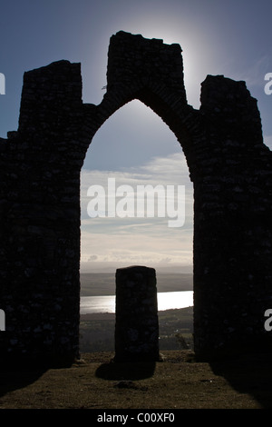 Silhouette of Fyrish Monument on Fyrish Hill in Easter Ross overlooking the Cromarty Firth - Stock Image
