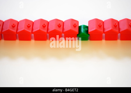 Row of monopoly hotels and green house - Stock Image
