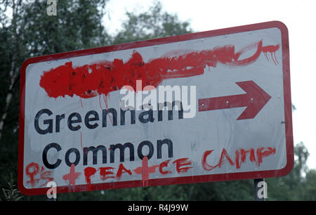 Berkshire road sign Greenham Common defaced with paint reading Peace Camp - Stock Image