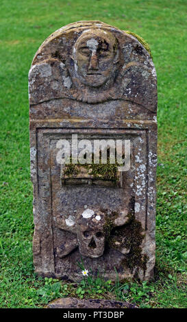 Gravestone with hourglass and skull and crossbones. Dryburgh Abbey. Dryburgh, St.Boswells, Roxburghshire, Scottish Borders, Scotland, United Kingdom. - Stock Image