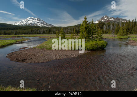 Oregon's South Sister (L.), Broken Top (R.) and Soda Creek - Stock Image