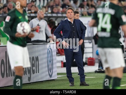 Wolfsburg, Germany. 22nd Apr, 2019. Soccer: Bundesliga, 30th matchday: VfL Wolfsburg - Eintracht Frankfurt in the Volkswagen Arena. Wolfsburg coach Bruno Labbadia observes the game in the arena. Credit: Peter Steffen/dpa - IMPORTANT NOTE: In accordance with the requirements of the DFL Deutsche Fußball Liga or the DFB Deutscher Fußball-Bund, it is prohibited to use or have used photographs taken in the stadium and/or the match in the form of sequence images and/or video-like photo sequences./dpa/Alamy Live News - Stock Image