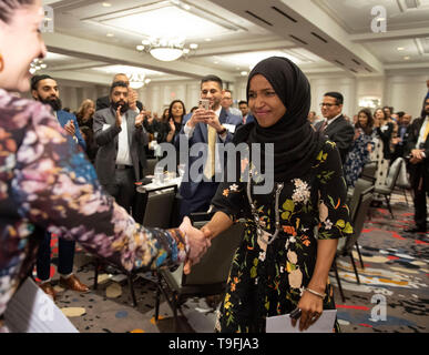 Austin, Texas, USA. May 18, 2019: Congresswoman Ilhan Omar of Minnesota's 5th Congressional District is introduced at Austin's annual city-wide iftar dinner in honor of the 14th day of Ramadan. Omar was joined by Mayor Steve Adler to call for peace and harmony in today's divisive climate. - Stock Image