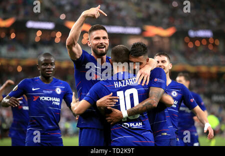 Chelsea players celebrate after Eden Hazard (centre) scores their third goal of the game - Stock Image