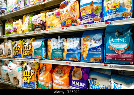 Shelves full of cat food for sale in a grocery store in Speculator, NY USA - Stock Image