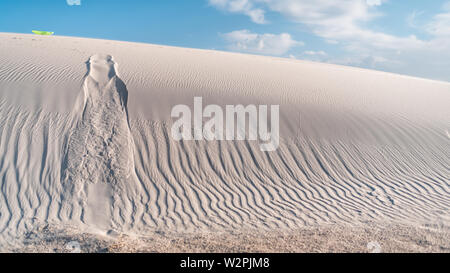 White sands dunes national monument in New Mexico and pattern from disk sled for sliding down hills - Stock Image