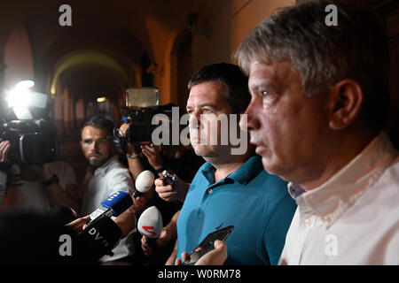 Prague, Czech Republic. 27th June, 2019. Czech Interior Minister and Chairman of CSSD Jan Hamacek, 2nd from left, and Deputy Chairman Roman Onderka, right, speak to journalists after meeting of CSSD leadership in Prague, Czech Republic, on June 27, 2019. Czechia is on verge of constitutional crisis, Hamacek said on Zeman's refusal to sack culture minister. He wants PM to come up with solution. Credit: Michal Kamaryt/CTK Photo/Alamy Live News - Stock Image