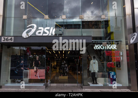 TORONTO, CANADA - NOVEMBER 13, 2018: Asics logo in front of their local store in downtown Toronto, Ontario. Asics is a japanse sportswear and footwear - Stock Image