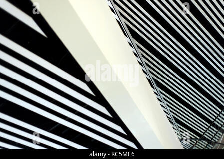 Stark and strong lines of a modern building interior creates an architectural abstract image with no people - Stock Image