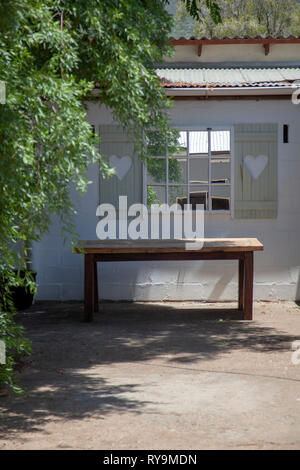 Cottage with Table - Stock Image