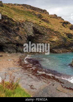 A cave on the beach at Tintagel in Cornwall - Stock Image